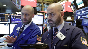 Wall Street slid lower on the Fed statement, but the S&P 500 finished only 0.5 per cent down.