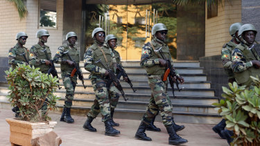 Soldiers from the Burkina Faso presidential guard patrol outside the Radisson Blu hotel in Bamako which was attacked in 2015.
