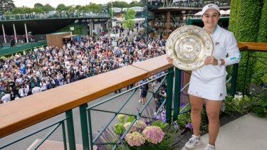 Barty with the Venus Rosewater Dish trophy after her breakthrough win at Wimbledon.