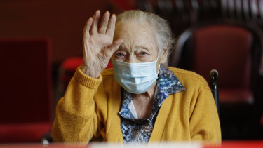 Marguerite Mouille, 94, waves goodbye to her daughter at the Kaisesberg nursing home, eastern France.