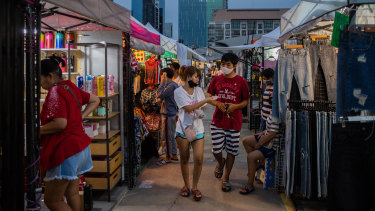 People browse the newly reopened Rot Fai Market in Bangkok, Thailand.