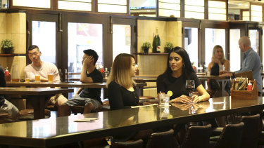 Patrons enjoy a drink at the Civic Hotel in Sydney's CBD.