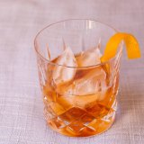 There are several non-alcoholic bourbons and whiskies which can work well in this New Old Fashioned.