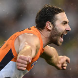 Flying: Jeremy Finlayson of the Giants celebrates kicking a crucial goal at the MCG.
