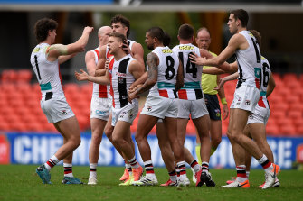 Jack Lonie celebrates a goal with teammates on Saturday. The Saints lost against Fremantle but have been playing an enterprising style.