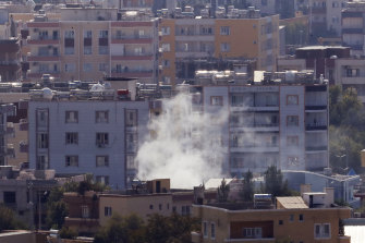 Smoke billows from targets in Ras al-Ayn in Syria on Friday.