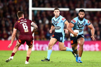 Payne Haas, right, playing in the blue of NSW, was the only Bronco in Origin II until his teammate Xavier Coates was recalled for Queensland.
