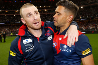 Neville Jetta with Melbourne's senior coach Simon Goodwin after the drought-breaking premiership.