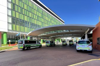 Ambulances wait outside of the emergency department at Sir Charles Gairdner Hospital.