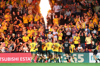 The Wallabies celebrating their victory in Brisbane.
