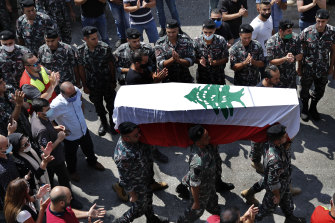 Firefighters carry the coffin of their comrade Rami Kaaki, one of 10 firefighters killed during the last week's explosion in Beirut.