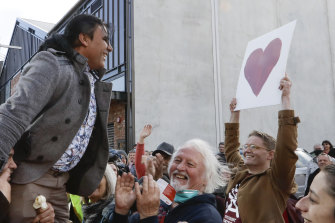 Mosque shooting survivor Abdul Aziz is held aloft as he thanks supporters outside the Christchurch High Court after Brenton Tarrant was sentenced to life without parole.