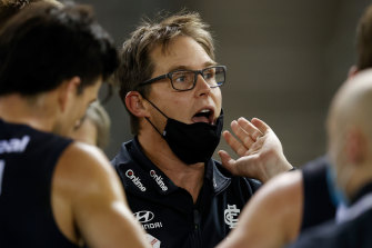 David Teague talks to his players during the clash with the Roos.