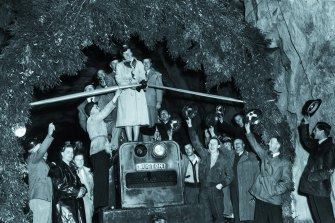 Lady Eileen Hudson cutting the ribbon to formally open the Guthega tunnel in 1954.