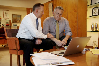 Once bitten: prime minister Tony Abbott and treasurer Joe Hockey prepare for the 2015 budget after their ill-fated first outing in 2014.