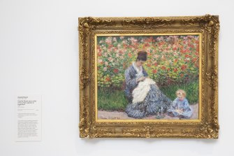 Camille Monet and a Child in the Artist's Garden in Argenteuil, by Claude Monet.