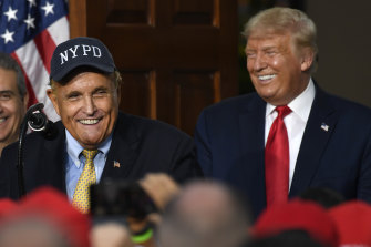 Rudy Giuliani, pictured with Donald Trump in 2020, has had his law licence suspended in New York.