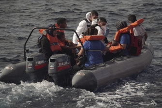 Members of the Maltese Armed Forces rescue a group of migrants in the Mediterranean Sea.