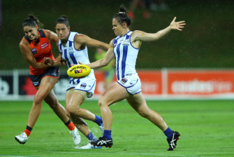 North Melbourne's Emma Kearney readies to kick against GWS Giants during an AFL Women's match in Sydney earlier this year.