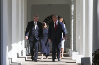 The two leaders, followed by their wives, at the White House.