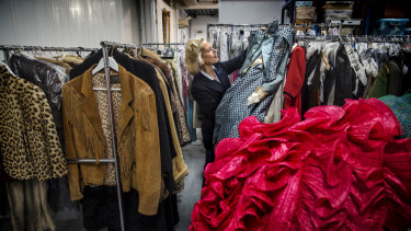 Charlotte Smith in the storage unit that houses her vast fashion collection. She hopes her sales will cut it down to half its present amount.