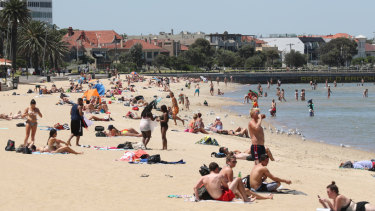 Crowds cooled off at St Kilda beach.