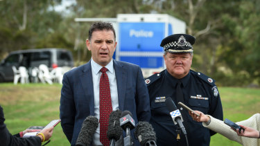 Homicide detective Andrew Stamper and Assistant Comissioner Luke Cornelius appeal for information from the public after a woman's body was found in Royal Park on Saturday.