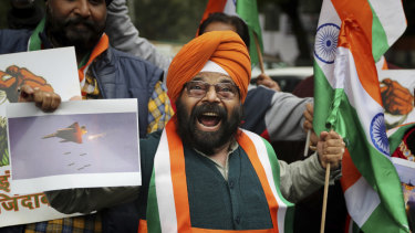 A man shouts slogans in support of India and against Pakistan as he celebrates reports of Indian aircrafts bombing Pakistan territory.