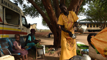 A woman prepares coffee at her stand at the Bentiu hospital in Bentiu, Unity State, South Sudan.