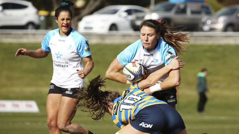 Canberra sevens playerAbby Gustaitis in action.