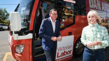 Daniel Andrews gets off the campaign bus with his wife Cath.