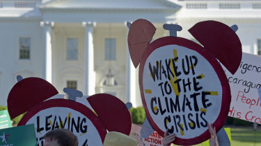 Demonstrators gather outside the White House to protest President Donald Trump's decision to withdraw the Unites States from the Paris climate change accord.