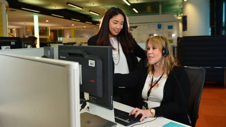 Medibank nurse Jonna Marisse Nayan (left) and consultant Janine Dunn at a Medibank customer support centre.