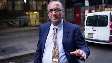Spiro Stavis leaves the ICAC hearing on Thursday.