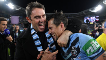Job done: NSW coach Brad Fittler congratulates his halfback Mitchell Pearce.