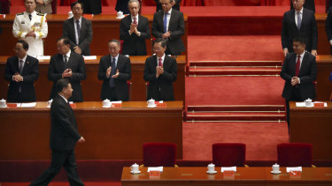 President Xi (bottom left) told the crowd of party members and successful Chinese identities that the country's policies would not be dictated by any other country.