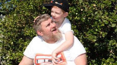 Leigh Whitten and his son Jaxon, who will start school next year.
