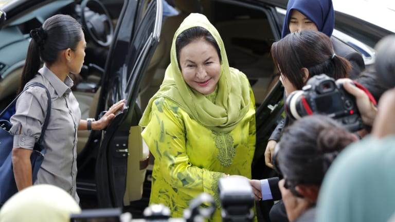 Rosmah Mansor (centre), wife of former Malaysian prime minister Najib Razak, arrives at the Anti-Corruption Agency for questioning.