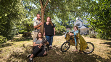 Out of the ashes: Black Saturday survivor Melanie Harris-Brady in front of the new house on her  Kinglake block, with husband Anthony, daughter Keeley, son Oscar and dog Toby.
