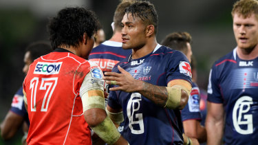 Before court: Amanaki Mafi shakes hands with a Sunwolves player after the Rebels' home game on May 25.