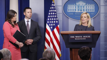 Homeland Security Secretary Kirstjen Nielsen, right, speaks while White House press secretary Sarah Huckabee Sanders, left, and Commissioner of U.S. Customs and Border Protection Kevin McAleenan, look on.