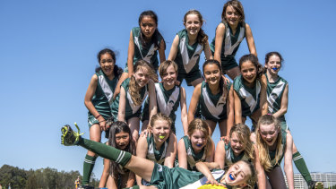 Wilkins Public School girls AFL side playing at Tempe Reserve.