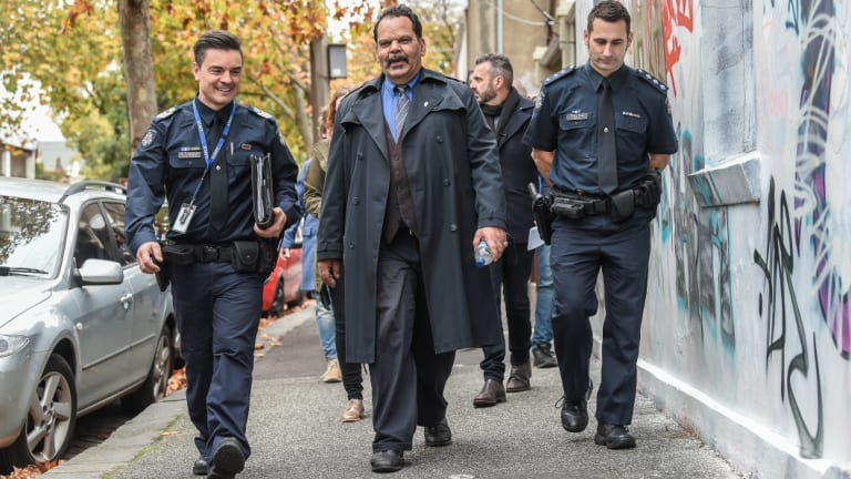 Jason Russell takes police officers for a walk through the streets of Fitzroy, where he used to be homeless.