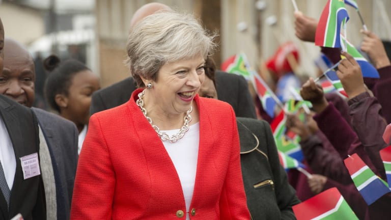 British Prime Minister Theresa May pictured in South Africa last week when trying to sell new trade deals with the UK.