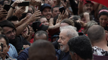 Brazil's former president Luis Inacio Lula da Silva, bottom, is mobbed by supporters as he is freed on Friday.