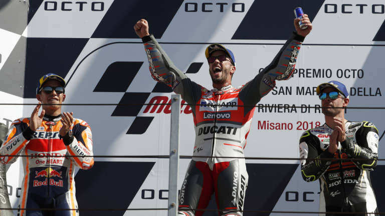 Dominant: Andrea Dovizioso is flanked by runner-up Marc Marquez (left) and third-placed Cal Crutchlow.