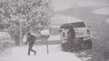 A child runs through snow to school in Black Springs in the NSW Central Tablelands on Friday.