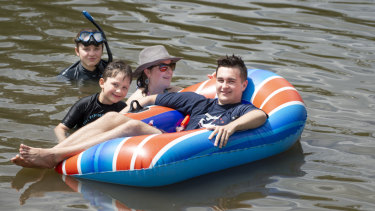 Canberra woman Michelle Love, pictured swimming at Casuarina Sands with her children Jazmin, 12, Axel, 6, and Jayden, 16, has welcomed a proposal for lifesavers to patrol the ACT's inland waterways.