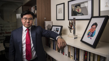 Tim Soutphommasane in his office with some of his Bill Leak cartoons.