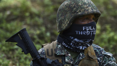 A Filipino marine pauses during firing during urban combat shooting at a firing range in Palawan, the Philippines.